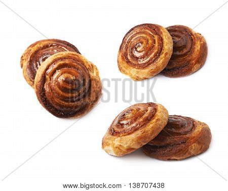 Two cinnamon roll pastry buns, composition isolated over the white background, set of three different foreshortenings