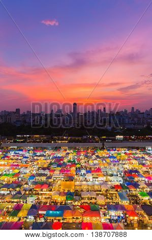 Aerial view multiple colour weekend market roof top with beautiful sunset sky background