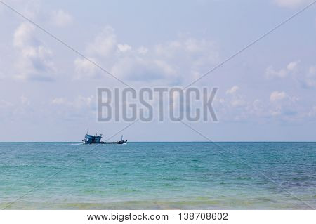 Fishing boast on the ocean skyline, natural landscape background