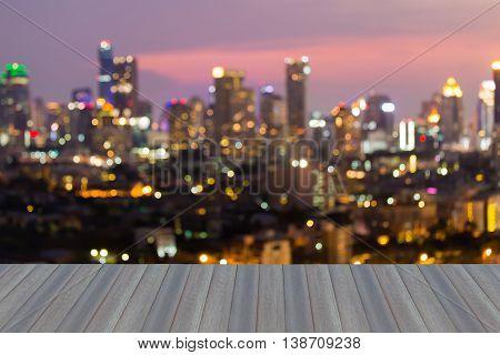 Opening wooden floor, abstract blurred bokeh big city lights night view