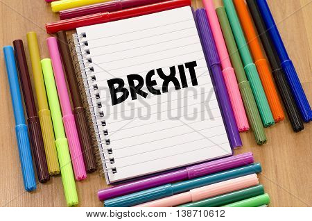 Brexit written on notebook over wooden background