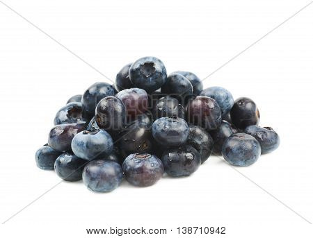 Pile of ripe bilberries isolated over the white background