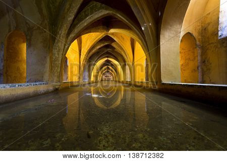 SEVILLE, SPAIN - September 12, 2015: View of the Baths of Lady Maria de Padilla rainwater tanks beneath the Patio del Crucero in the Alcazar of Seville on September 12, 2015 in Seville, Spain