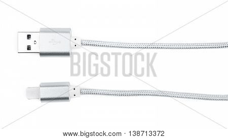 Close-up fragment of the silver metal USB lightning cable isolated over the white background