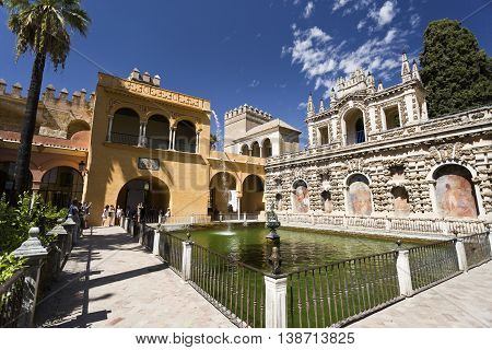 SEVILLE, SPAIN - September 12, 2015: View of the pool and Grotto Gallery (Galeria de Grutesco) in the gardens of the Alcazar of Seville on September 12, 2015 in Seville, Spain