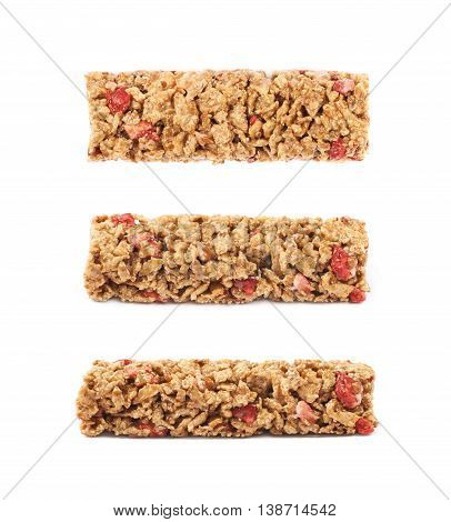 Nutrient chewy grains bar isolated over the white background, set of three foreshortenings