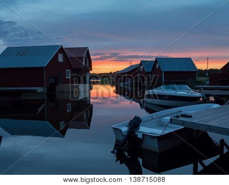 Midnight light and fisherman cabins on the Swedish east coast  after the sunset