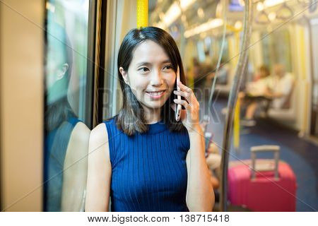 Woman talk to mobile phone on train