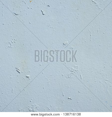 Close-up fragment of an old painted metal surface as a background texture composition