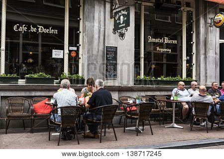 AMSTERDAM NETHERLANDS JULY 9 2016.cafe de doelen in typical district of Amesterdam with people sitting on a terrace NETHERLANDS