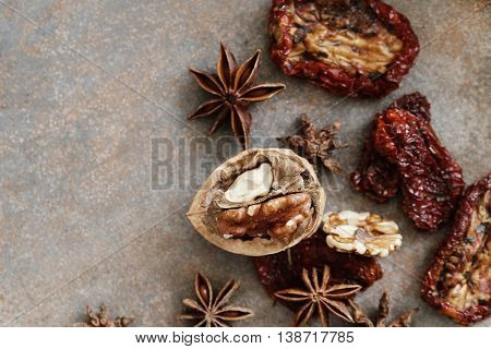 Dried tomato and anise flower on the table