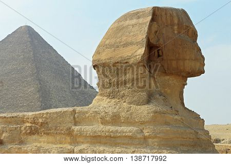 Sphinx statue and Pyramid in Giza Egypt. Ancient architecture