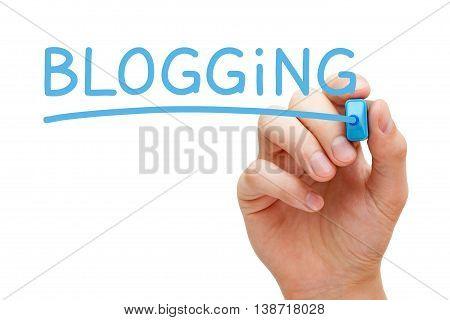 Hand writing Blogging with blue marker on transparent wipe board.