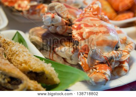 Freshly boiled crabs on sale at a local market Samut Songkhram Thailand. Travel cuisine abstract.
