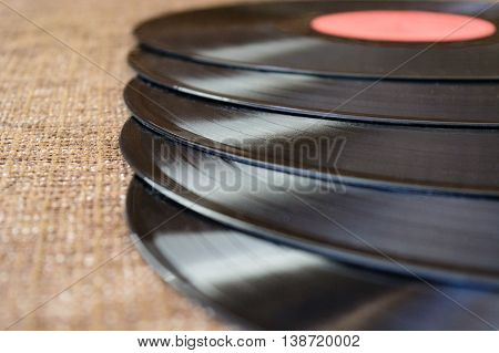 composition from five vinyl records lie on fabric
