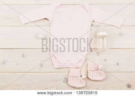 Baby Clothes And Milk Bottle
