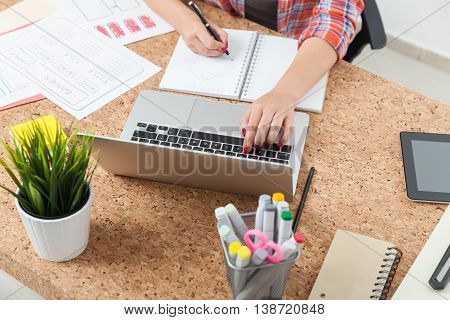 Woman Typing And Writing