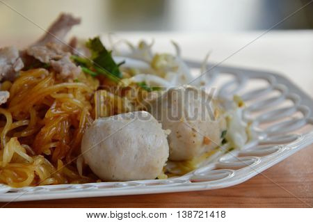 rice noodle filling pork ball and bean sprout on plate