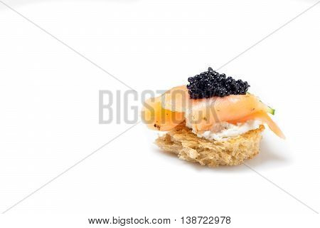 Smoked Salmon Appetizer with Cream Cheese and Caviar isolated on white