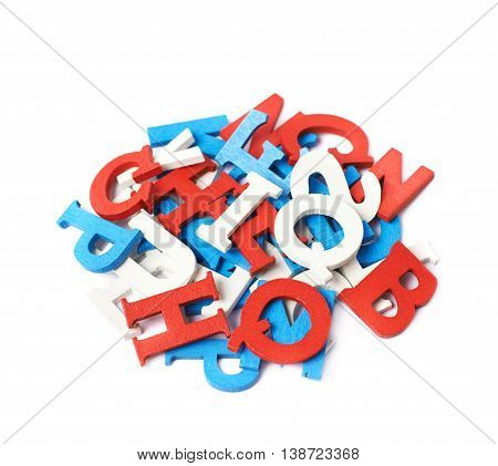 Pile of red, blue, white painted wooden letters isolated over the white background