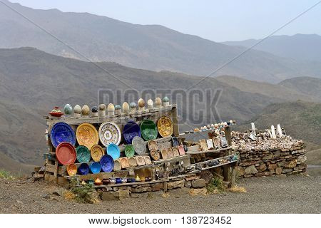 ATLAS, MOROCCO - JULY 10: Souvenirs stand on the side of the road on July 10, 2013 in Atlas Mountains, Morocco. Road in Atlas Mountains very popular tourist route in central Morocco.