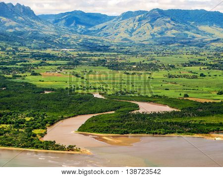 River estuary aerial landscape with fields and hills