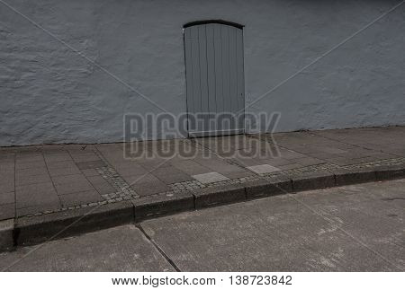 Old wooden door in the wall of a building