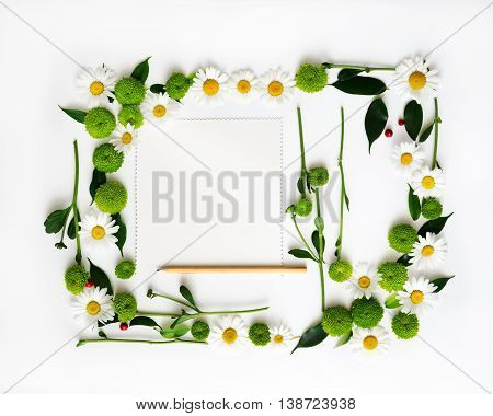 Paper And Pencil With Wreath Frame Flowers.