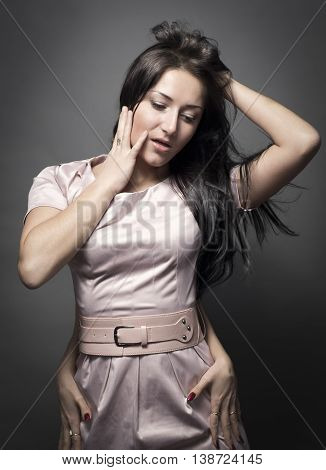 portret of young beautiful lady with a hands