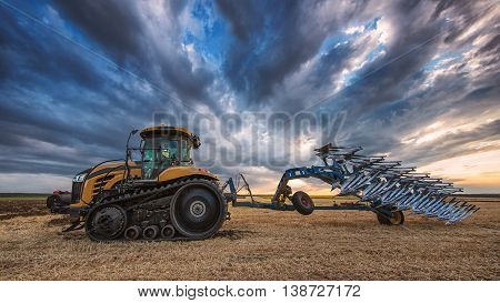 Tractor With Plough, Plowing In A Field