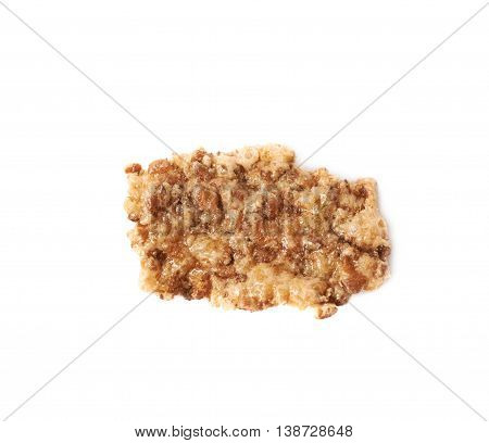 Single wholegrain cereal flake isolated over the white background