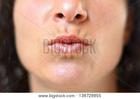 Woman Pursing Her Lips For A Kiss