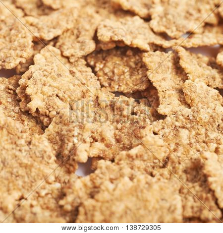 Surface coated with the wholegrain cereal flakes as a texture backdrop composition