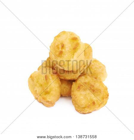 Pile of multiple breaded chicken nuggets isolated over the white background