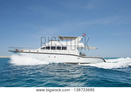 Luxury Motor Yacht Sailing On Tropical Sea