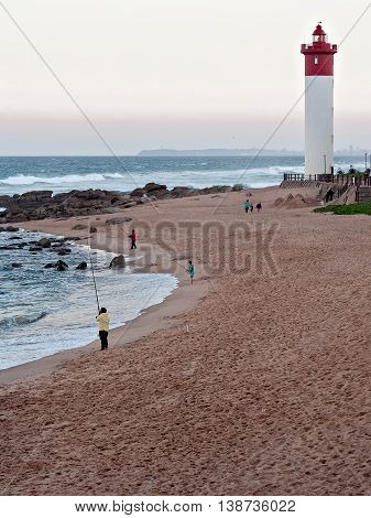 DURBAN SOUTH AFRICA - JULY 11 2016: Anglers on the Umhlanga Rocks beachfront near Lighthouse