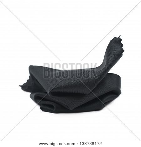 Crumbled glass cleaning black cloth napkin, composition isolated over the white background