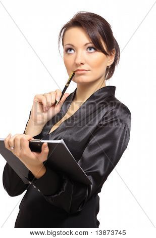 Portrait of a young female entrepreneur thinking while taking notes against white background