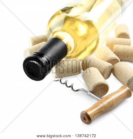 White wine with corkscrew, isolated on white