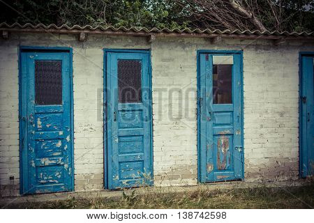 Grunge free public toilet cabin close to the Black Sea beach