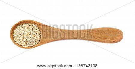 Wooden serving spoon filled with quinoa seeds isolated over the white background