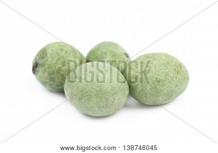 Green wasabi coated peanuts isolated over the white background
