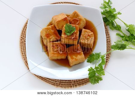 Sweet and sour tofu on dish vegetarian food.