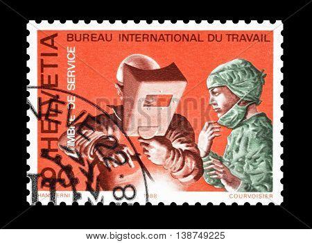 SWITZERLAND - CIRCA 1988 : Cancelled postage stamp printed by Switzerland, that shows welder.