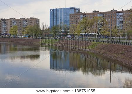 KHARKIV UKRAINE - APRIL 26 2015: On the waterfront of Kharkiv. View from the bridge