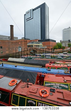 BIRMINGHAM, ENGLAND - JUNE 12: Colorful narrow boat, typical houseboats in West Midlands, England on June 12, 2013. Birmingham Canal is popular for leisure and has a number of narrow boat hire centers