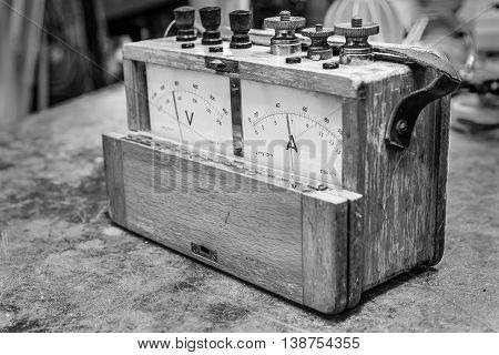 Vintage analog wooden electric meter on the old table test