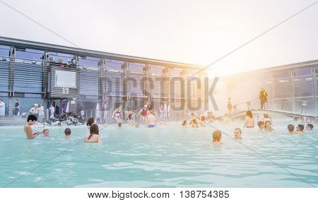 BLUE LAGOON, GRINDAVIK, Iceland - June 20, 2016: People in geothermal spa baths on a sunny day