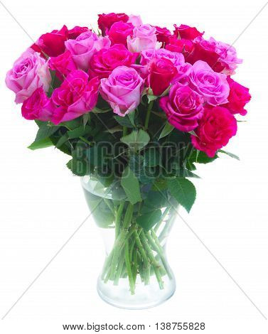 bouquet of pink and magenta fresh roses in vase isolated on white background