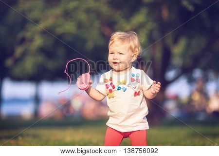 Baby playing on Outdoors.Computer mouse in hand.